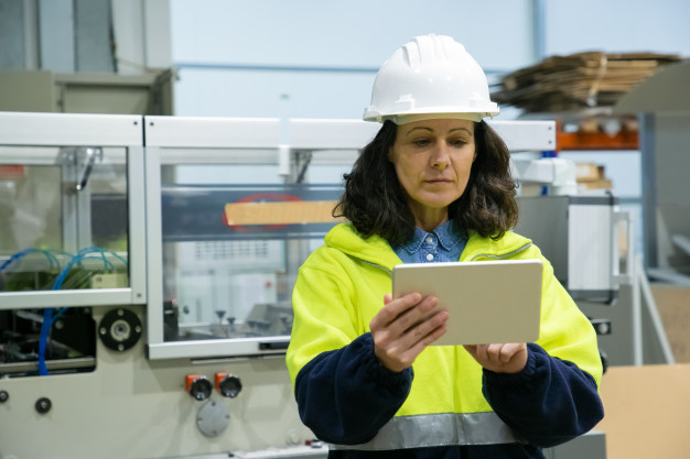 female-industrial-worker-using-tablet-computer-site_74855-5384